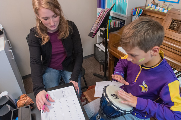 Christina Harman gives a music lesson to Jacob Jackowell, 7, at Music Mart. Harman said she has been teaching music for 10 years. Photo by Jackson Forderer