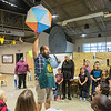 Chris McEachron, Program and Education Manager at the Children's Museum of Southern Minnesota, lets the big ball drop as children counted down to New Year's, for parts of India and Pakistan. McEachron taught children how to say happy new year's in Bengali, subha naba barsa, as well as other languages as New Year's celebrations spanned the globe. Photo by Jackson Forderer