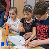 From left, Emily Duffey, 5, Aubree Steffen, 5, and Noah Steffen, 11, make items to put into the wind tunnel at the Children's Museum of Southern Minnesota on Monday. Children were encouraged to write their New Year's wishes onto streamers to send into the air in the wind tunnel. Noah said his New Year's wish was that more people loved God while his brother Miles wished to be a YouTube star. Photo by Jackson Forderer