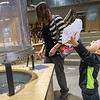 Knox Fausch, 5, catches a 'snowflake' that blew out of the wind tunnel at the Children's Museum of Southern Minnesota on Monday. The museum had various activities for children to do to ring in the new year. Photo by Jackson Forderer