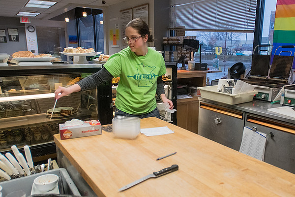 Courtney Schweim cleans up behind the front counter at Friesen's Bakery on Thursday. Photo by Jackson Forderer