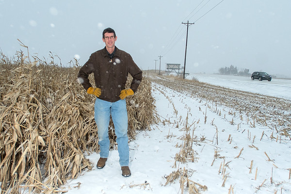 Dave Woestehoff stands next to a living snow fence along Highway 169 in rural Belle Plaine as a blizzard blew through the area. Woestehoff said that the State of Minnesota realized that when there is standing crop, there is less snow and drifting on highways. Photo by Jackson Forderer