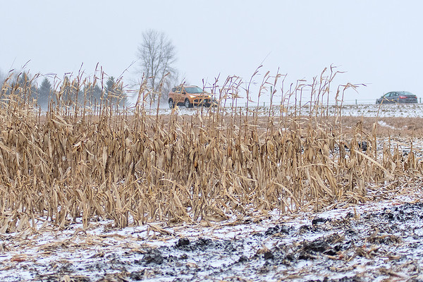 Traffic passes by a snow fence along Highway 169 in rural Belle Plaine on Monday as a late December blizzard dusted the area. Photo by Jackson Forderer