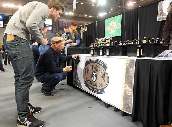 Visitors to the Craft Beer Expo check out the selection of beers from the Brau Brothers Brewery in Lucan, Minn. Saturday.