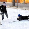 Parker Wittenberg, 8, tries to keep his brother Jack, 10, from scoring while playing hockey on a rink in West Mankato's Dotson Park.