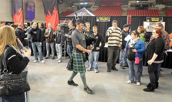 Third Street Brewery's Bob McKenzie plays the bagpipes to announce the start of the Mankato Craft Beer Expo Saturday.
