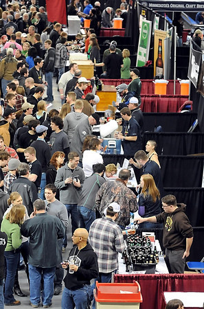 Brewers from across the country pour samples of their craft beers for visitors at the inaugural Mankato Craft Beer Expo Saturday at the Verizon Wireless Civic Center.