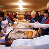 John Cross<br /> Volunteers assemble some of the 3,000 or so hamburger lunches that were delivered throughout the community Friday during the Mankato Eagles Club Bite-A-Burger fundraiser. The event raises money for palliative care at Mayo Clinic Health System's Andreas Cancer Center.