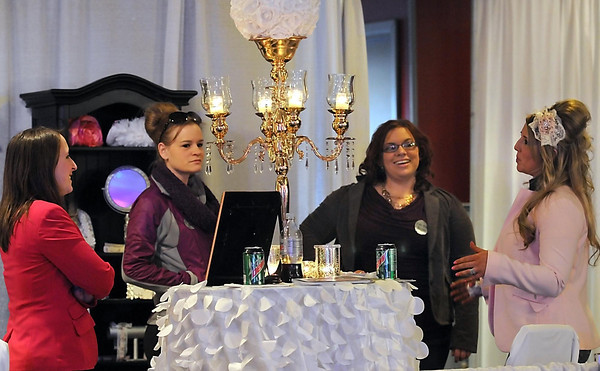 Pat Christman<br /> Brides to be check out table settings and centerpieces at one of the many booths Saturday.