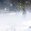 Pat Christman<br /> A student leaving Mankato East High School is surrounded by blowing snow as he makes his way home after school was dismissed early Thursday afternoon.