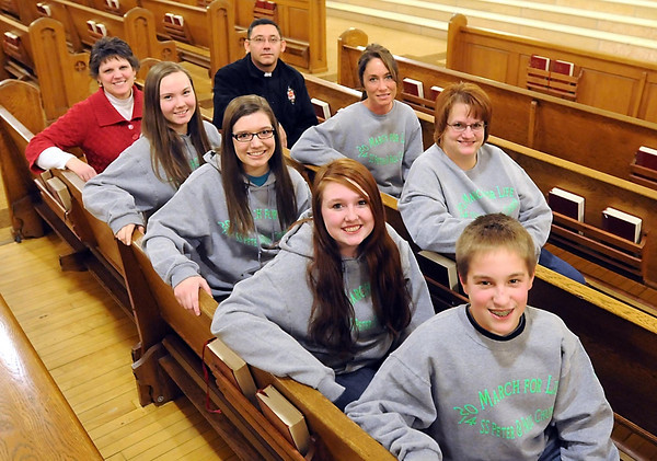 Pat Christman<br /> Front row from left, Beth Shenck, Christian Bach, Cassidy Krueger, Kallie Taylor and Joe Miller. Back from left, Fr. Mariano Varela, IVE; Beverly Miller and Melissa Taylor