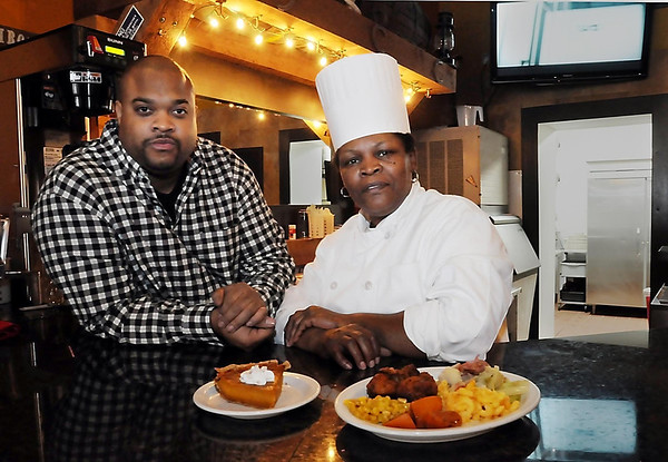 John Cross<br /> Daisy's Sould Food owner Darius Knox and his cook, Amy Body, show off a Daisy's Sould Food specialty _ a plate of fried chicken, the fixins' and a slice of sweet potato pie.