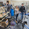 Executive Director of Key City Bike Acacia Wytaske (center) works with new volunteer Ronan Corley while Brian Gosewisch (holding wheel) works with Dakota VanLinden and Matt Menze at the non-profit's new space in the old CCTV building. The square footage is more than triple of what their old building used to be. Photo by Jackson Forderer