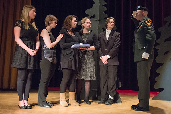 Patrick Leigh (right) and other Waseca High School students, go through a dress rehearsal of the one act play called Booby Trap at the Waseca Public School District auditorium on Thursday. The play's director Karen Pfarr Anderson said that veterans have been coming forward to donate military uniforms and other medals for the play that focuses on a soldier caught on a land mine. Photo by Jackson Forderer