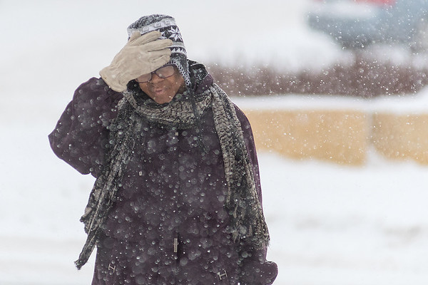 Velma Jefferson adjusts her hat as she crosses the street at the intersection of Warren St. and Front St. in Mankato on Friday afternoon. Photo by Jackson Forderer