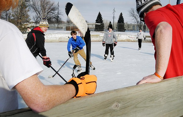 An early dimissal for semester finals in Mankato's high schools and a bit of a January thaw on Friday enticed some students to organize a game of pick-up hockey game at Spring Lake Park. Photo by John Cross