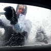Stacie Noha scrapes ice from her windshield outside her dorm room Saturday on the Minnesota State University campus in Mankato. File photo