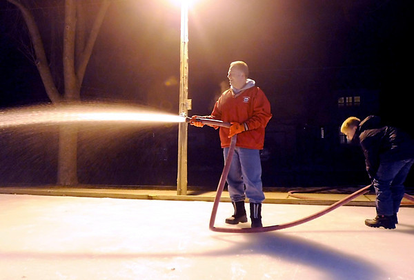West Mankato resident Jed Falgren and son Joey tend to ice rink duties in Dotson Park in Mankato. Falgren has been mantaining the popular rink since the city stopped doing it in 2003.