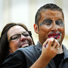 John Cross<br /> Dakota Meadows Principal Carmen Strahan applies make-up to Principal's Assistant Brian Hansen without looking.