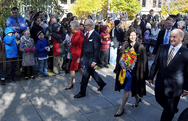 A crowd lines the walkway through Eckman Mall as King Carl XVI Gustaf and Queen Silvia of Sweden make their way to Christ Chapel Friday at Gustavus Adolphus College.