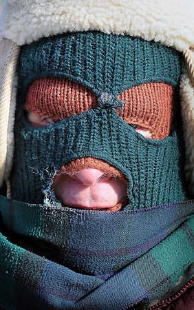 John Cross<br /> A pedestrain walking along Monks Avenue used a layering technique as protection against Monday's frigid temperatures.