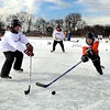 A pair of teams compete in a championship bracket game at the Anthony Ford Memorial Pond Hockey Tournament Saturday on Lake Washington.<br /> <br /> Pat Christman