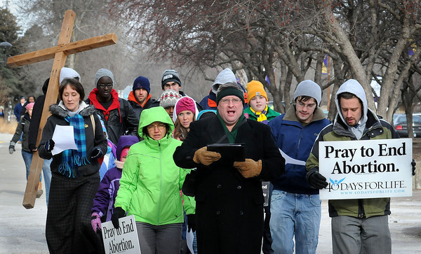 Johnathon Bislew of Maranatha Christian Fellowship (center) leads marchers through the mall at Minnesota State University on Tuesday to call attention to a 1973 U.S. Supreme Court decision that legalized abortion.