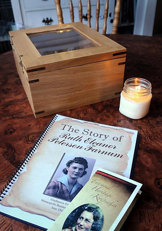 In addition to spiral-bound books, hand-made keepsake boxes are designed to store the books along with other memorabilia.