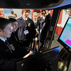 Seth Melson (front) and Chris Kahler, members of the Martin County West FFA, operate a tractor simulator at the MN Ag EXPO 2013 at the Verizon Wireless Center on Monday. The event continues through today.