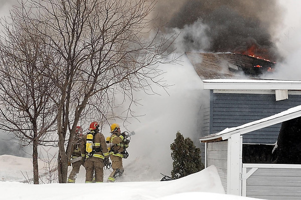 John Cross<br /> North Mankato firefighters battle a mobile home blaze in the 2000 block of Lancelot Lane on Thursday.
