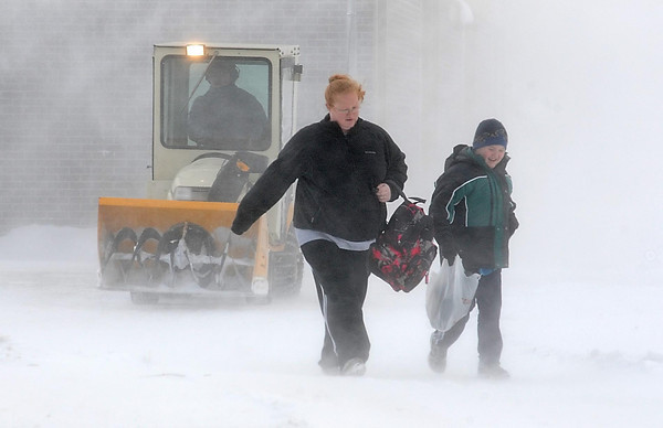 John Cross<br /> A parent and student leave Hoover Elementary School in North Mankato, Minn. in white-out conditions on Wednesday after high winds accompanied by frigid temperatures prompted offcials to dismiss classes early. Many schools acrossed south-central Minnesota dismissed early because of the blizzard conditions.