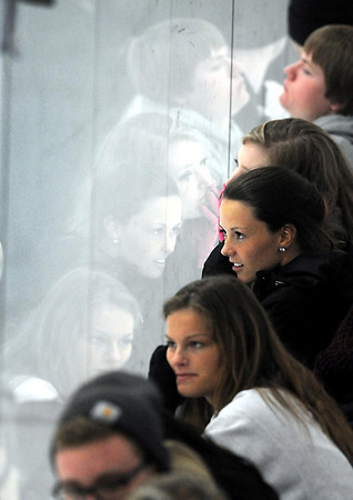 Pat Christman<br /> Fans watch the Mankato East/Loyola boys hockey team take on crosstown rival Mankato West Tuesday night at All Seasons Arena.