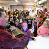 Pat Christman<br /> Kids eagerly wait to hear their names during the raffle at the youth ice fishing contest Saturday.