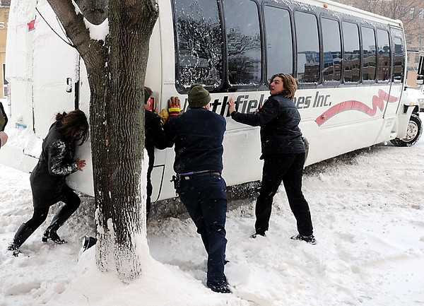 John Cross<br /> High School students from Northfield in Mankato for a mock trial give their stuck bus a helping hand on South Second Street on Thursday.
