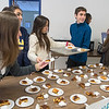 From left, Mica Clausal (16), Delfina Santanocita (17), Martina Conde (16) and Francisco Stroia (17), exchange students from Argentina, serve up pieces of flan for dessert in the cafeteria at Mankato Loyola on Wednesday. The students are able to participate in the exchange program as it is their summer break now. Photo by Jackson Forderer