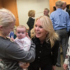 "U.S. Senate candidate Karin Housley (R) greets Jessica Hastings (left), a senior at Gustavus, and Amber Raddatz, 10 weeks old during her stop at the Blue Earth County Republican headquarters in Mankato on Tuesday. Amber's mother Azzizeh Raddatz (right) said, ""She's our little Blue Earth County Republican."" Photo by Jackson Forderer"