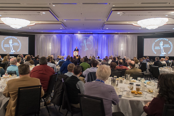 Gov. Tim Walz speaks at the Minnesota Newspaper Association Convention in a ballroom at the DoubleTree Hotel in Bloomington on Friday. Photo by Jackson Forderer