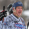 Mike Steele, 59, watches his teammates on the Wood Butchers team play against the Orange Lazers in one of the final Saturday games at the Anthony Ford Pond Hockey Tournament at Spring Lake Park. The tournament continues today with youth divisions playing on the frozen pond. Photo by Jackson Forderer