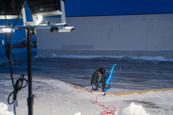 Dain Fisher lays down LED lights that will be under the ice at a skating rink in The Hub in Mankato. Fisher also wants to build an igloo with all the snow removed from the lot. Photo by Jackson Forderer
