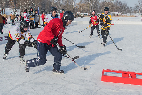 Team Dirty Birds plays against Team Schwickerts in a game during the Anthony Ford Pond Hockey Tournament held at Spring Lake Park on Saturday. The Dirty Birds won the game 12-6. Other team names in the adult divisions included Hat Trick Swayze and Puck Puck Grey Puck. Photo by Jackson Forderer