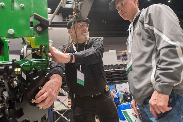Zane Freeland (center) with Planter Pro shows Ray Thomas from West Concord a row cleaner at the Ag Expo held on Wednesday at the Verizon Performance Hall. Photo by Jackson Forderer