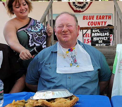 John Cross<br /> Blue Earth County Commissioner Will Purvis basks in the glory of being declared the winner of a pie-eating contest by Corbin Peterson of Bakers Square as also-ran,  Mankato Mayor Eric Anderson, looks on at the Blue Earth County Fair on Saturday.