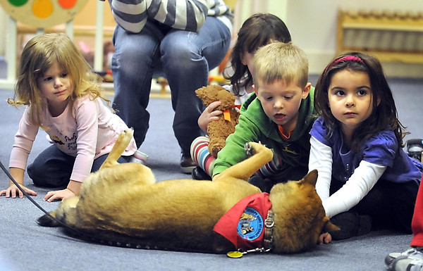 Pat Christman<br /> From left, Stacy Zierdt, Chase Lee and Madison Huper pet a therapy dog named Nikko during a visit to the Children's Museum of Southern Minnesota Saturday morning.