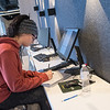 Carlee Giles, a nursing student at Rasmussen College, studies in a nook at the school on Thursday. The college's new space in Madison East features small areas for studying, but also wide open classrooms. Photo by Jackson Forderer
