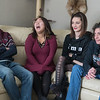 Cole Sanow (left) and Sara Guymon (second from left) laugh after Jenn Magers (right) called the two of them her 'free range children'. Sanow, 18, and Guymon, 17, are two of Jules Reed's (second from right) best friends and have helped her recover from a nearly fatal accident in rural Nicollet. Photo by Jackson Forderer