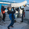 From left, Zac Aasen, Isaiah Gaylord, Mary Lou Jewison and Will Mason lift a queen-size mattress onto the back of Mason's pick up truck at My Mankato Storage on Saturday. Multiple area businesses donated materials such as lumber, mattresses, bedding and labor to make the bed drive possible. Photo by Jackson Forderer