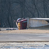 A semi truck driver carrying soy beans rolled over while turning south to continue on Highway 14 outside of New Ulm on Tuesday at 1:15 p.m. Photo by Jackson Forderer