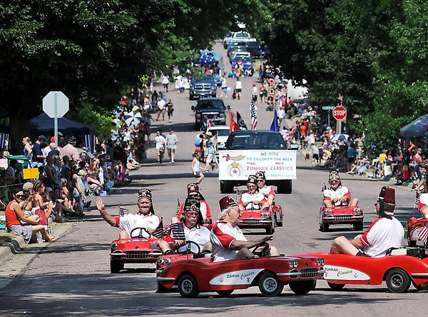 John Cross<br /> Shriners perform their precision driving routine for crowds lining the streets Wednesday for  St. Peter's Old Fashioned 4th of July Parade.
