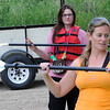 At right, April Femrite, general manager of Bent River Outfitters, gave instructions on how to hold the paddle and how to steer before we all took off down the Minnesota.