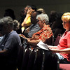 People look over information relating to the release of level three sex offender Gregory Eugene Ward during a notification meeting Thursday at the Verizon Wireless Center.